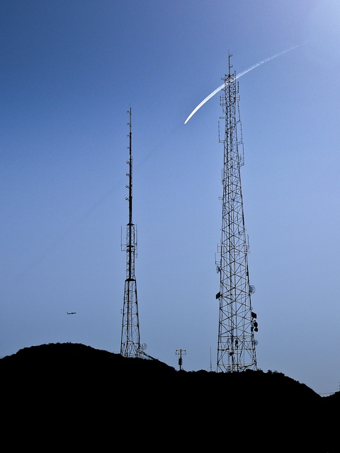 planes sky contrail radio towers